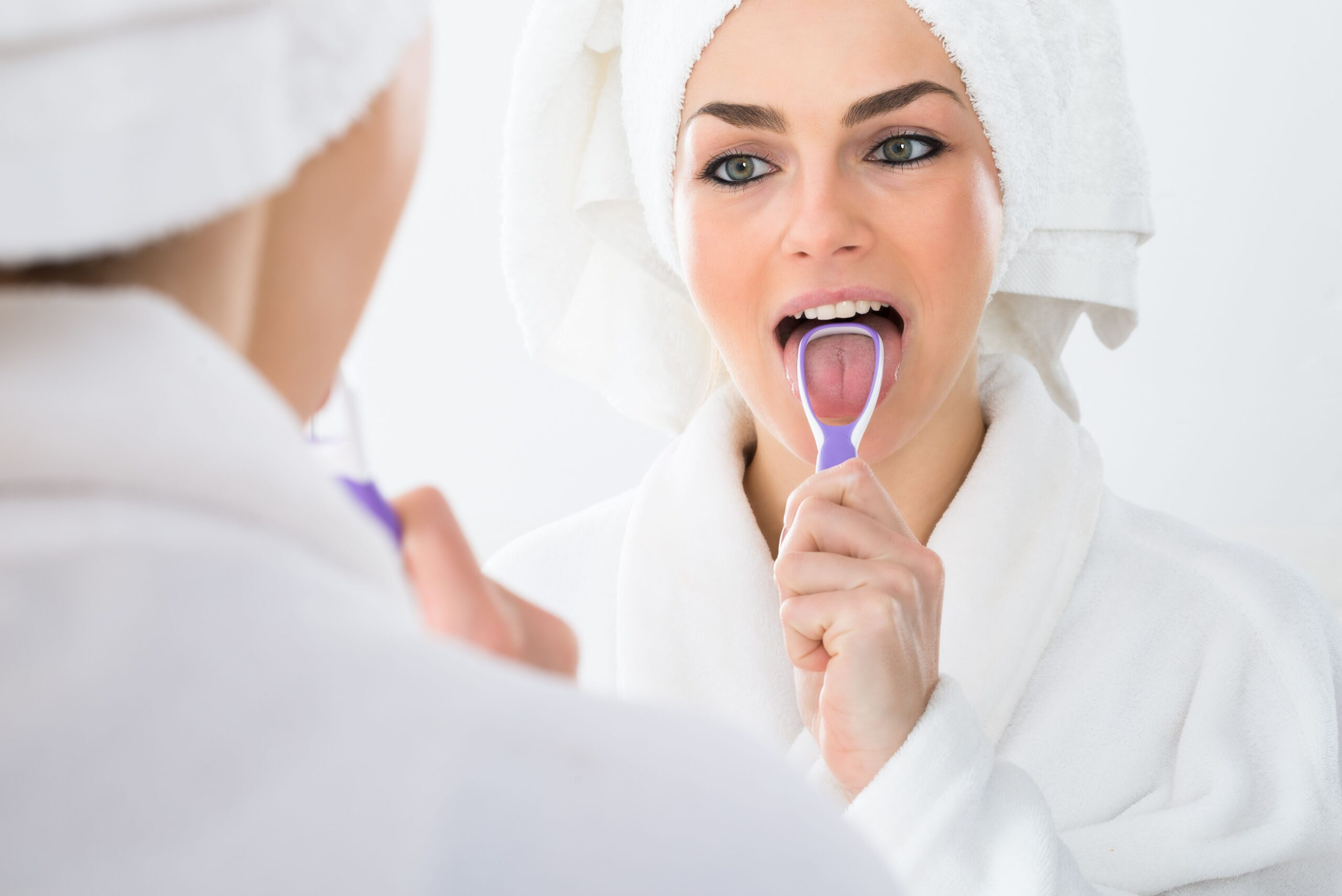Lake View Dentist | Should I Be Using a Tongue Scraper?
